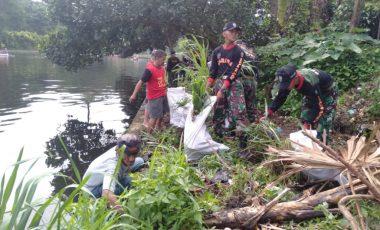 Yonif 315/Garuda Berkolaborasi Dengan Pemkot Bogor Melaksanakan Bebersih Sampah di Danau Situgede